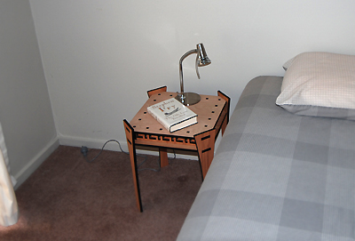 J. Wegesin's square table by bed