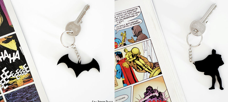 Laser cut black acrylic Batman and Superman keychains from SolPixieDust