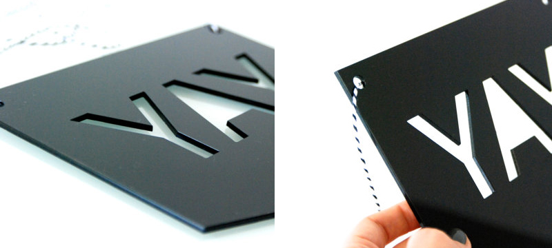 Laser cut matte black acrylic YAY sign from HopStudio